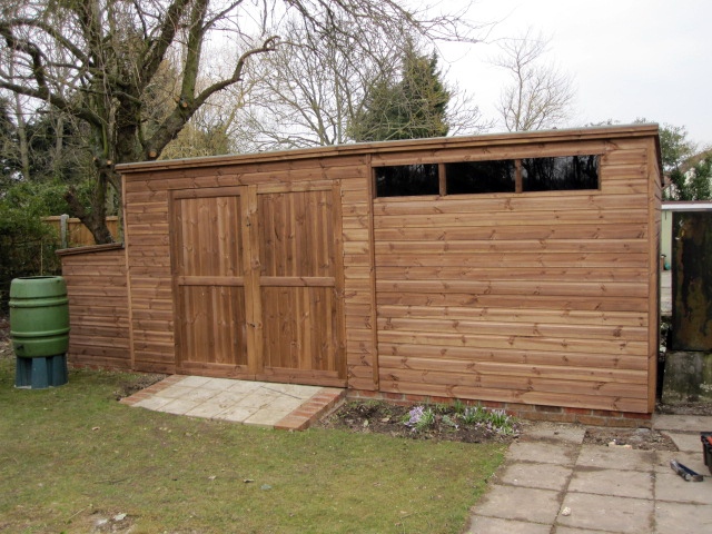 17 x 10 pent with 78 inch wide joinery doors and slit windows