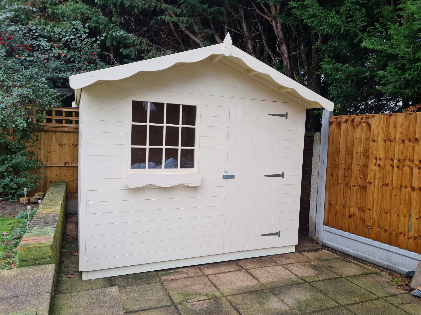 9 x 8 cabin style garden shed  with right hand door.  This has been painted white using Protek Royal Exterior Superior wood finish